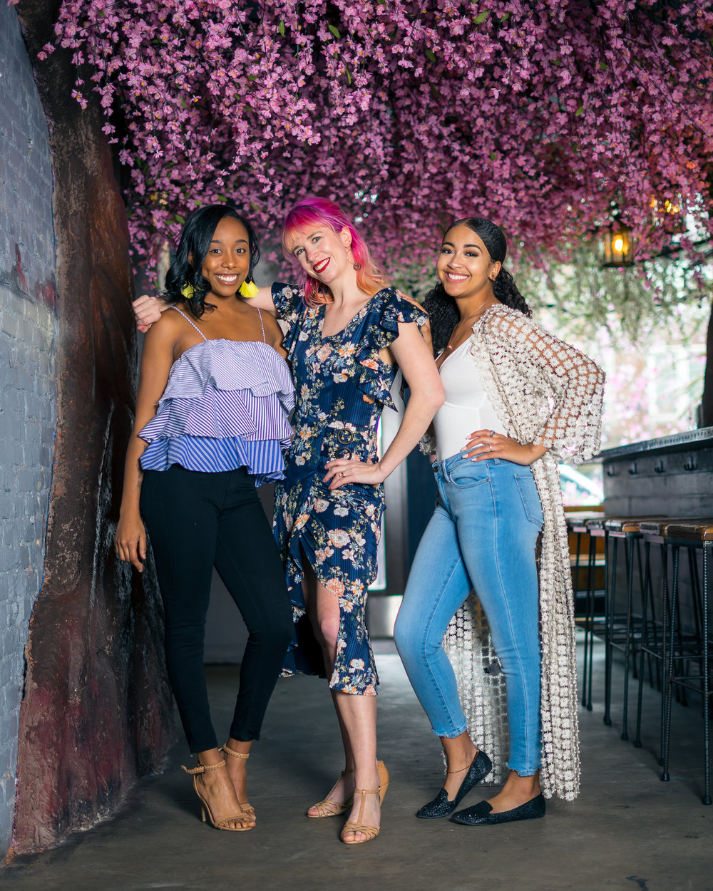 On Kandace:  Flounce Top ($44), Black Jeans ($64)  On Kiki:  Floral Wrap Dress ($96)  On Tia:  White Bodysuit ($16), Pearl Floral Kimono ($165), Jeans ($64)