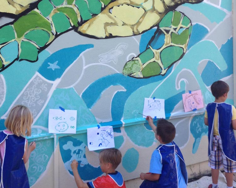 Kids paint their part of the Turtle Mural at Emerald Park, design by Muralist Bayne Gardner.
