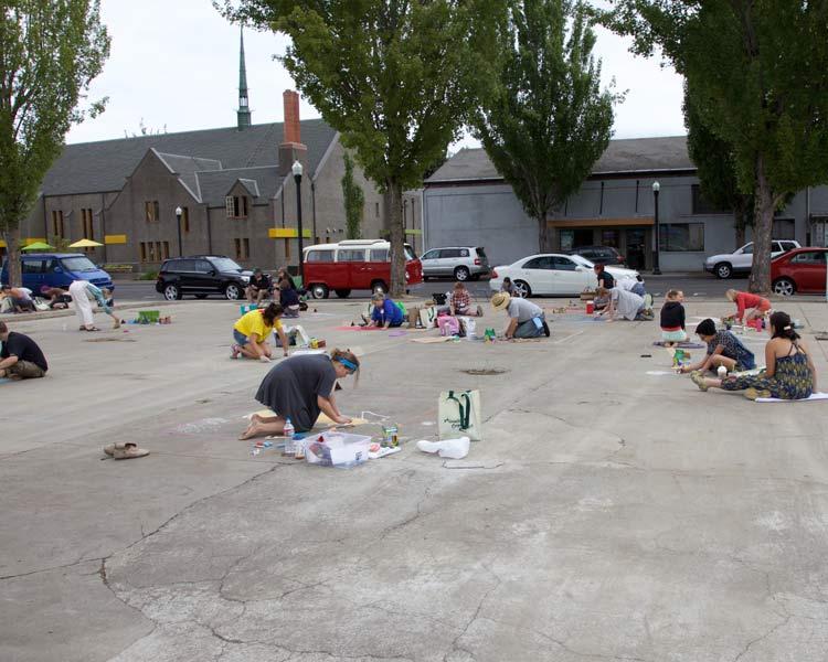 Artists begin their chalk art at the Springfield Art & Chalk Festival.