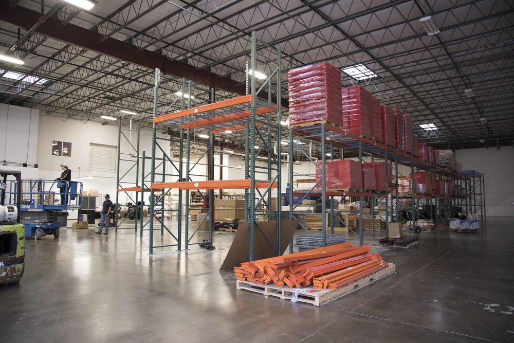 Shelves at Imagination International warehouse