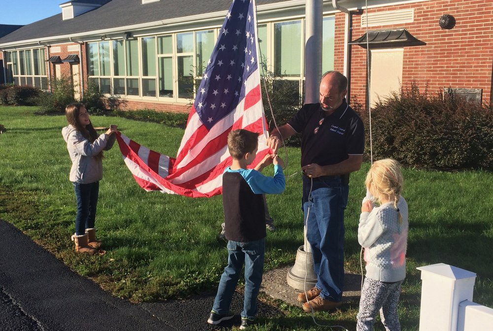 Raising the flag at the Kent Before School Program