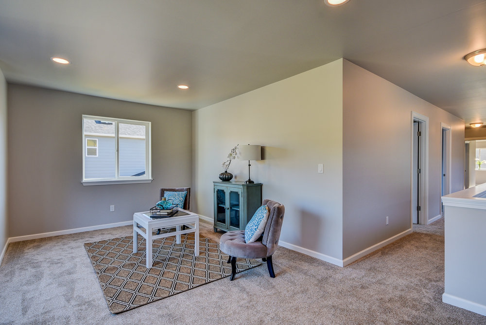 A look at the bonus! This space is perfect for a 2nd family room, craft station, play area, home office, OR you can have it converted into a 4th bedroom (a $1500 upgrade)!......