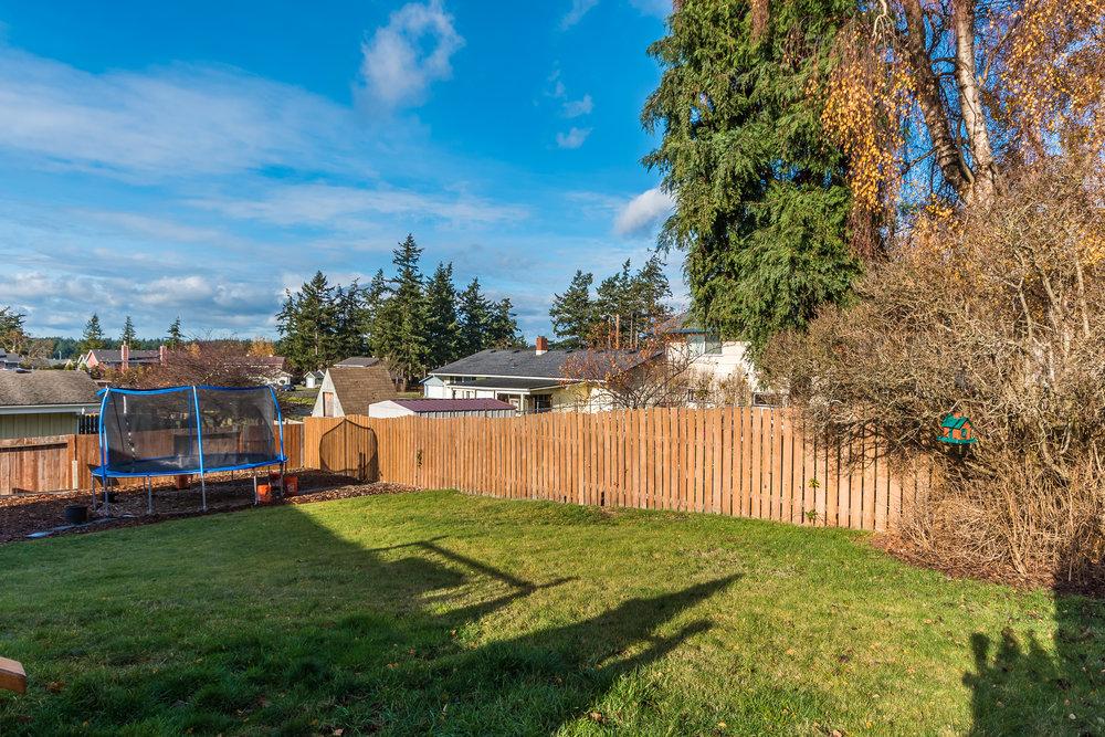 A fantastic, fully fenced back yard...complete with sprinkler system!