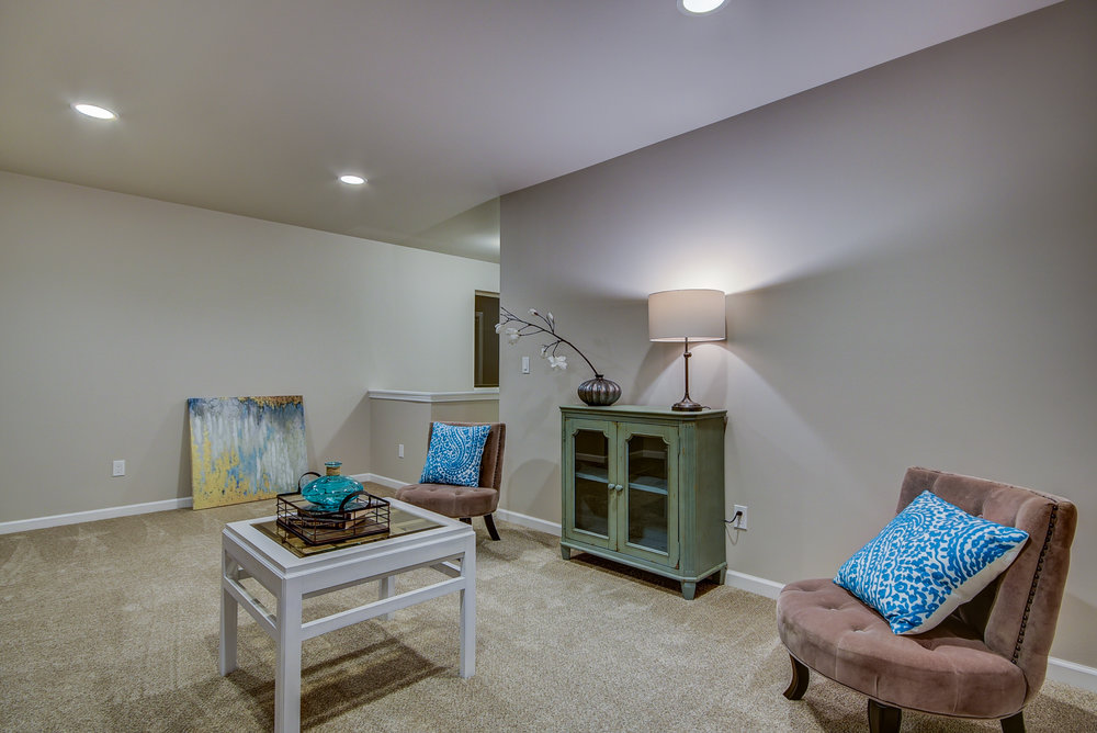 A look at the bonus! This space is perfect for a 2nd family room, craft station, play area, home office, OR you can have it converted into a 4th bedroom (a $1500 upgrade)!............