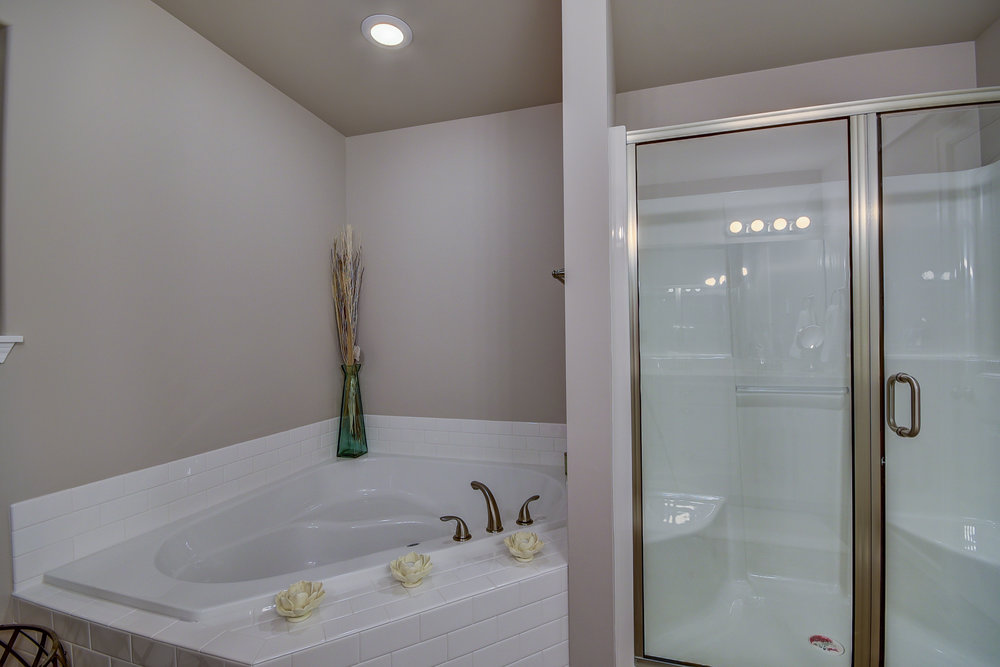 Master bath with corner soaking tub (comes standard) & shower...