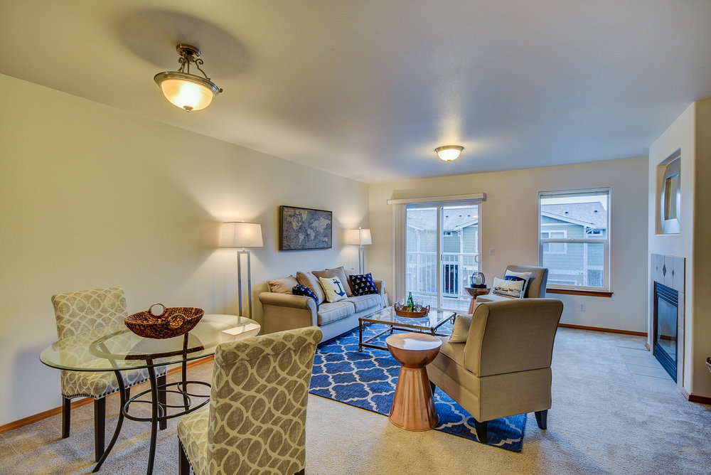 High ceilings, natural light, gas fireplace, & balcony for fresh air make this space both efficient & inviting...