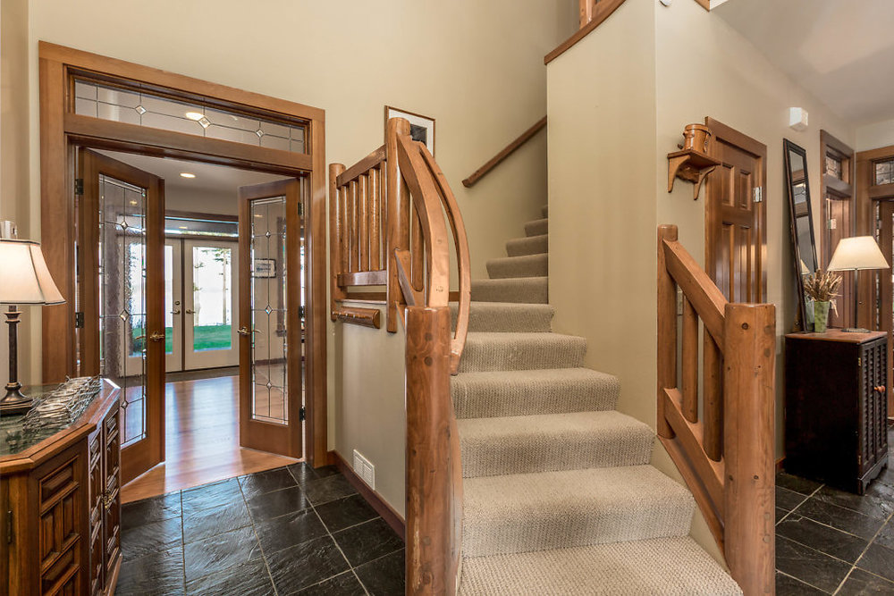 Welcome...slate tile floors, and leaded glass doors, beautiful hand banister...and this is just the entrance...