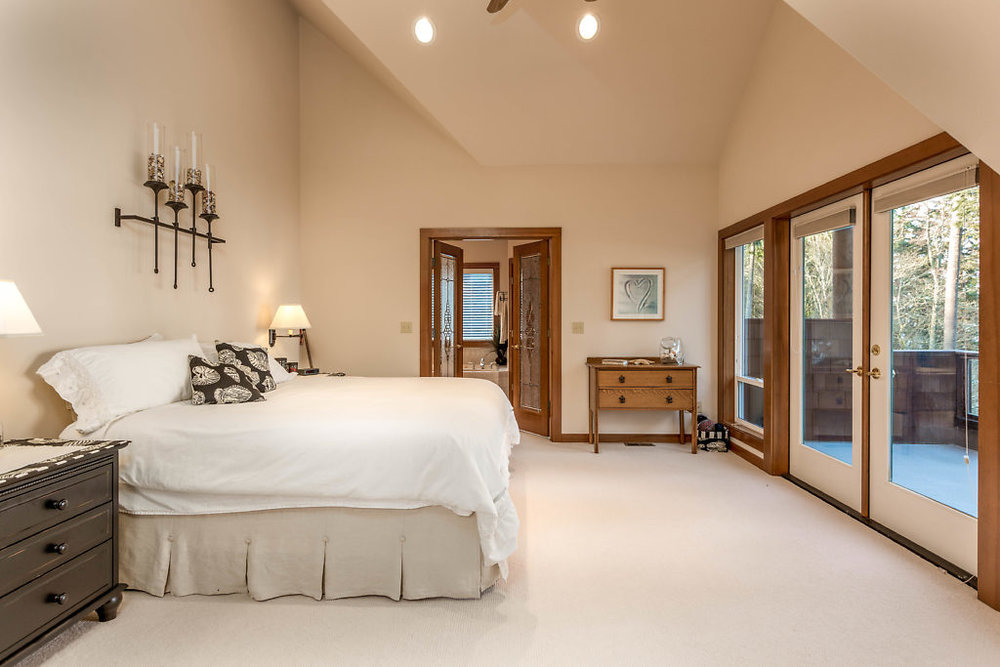 Master suite with soaring ceilings & French doors...