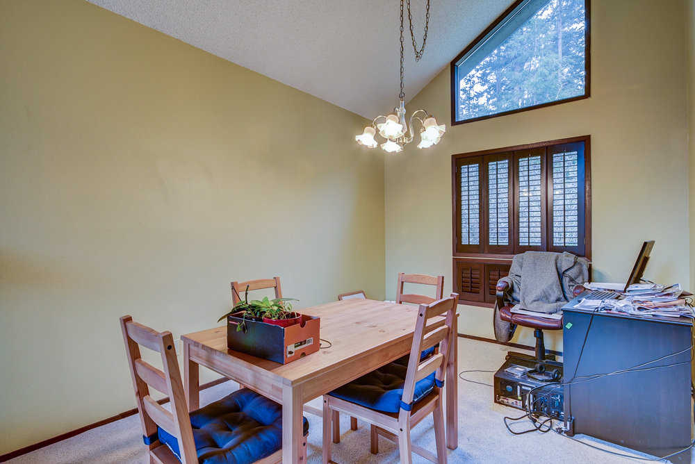 Dining room...if you take away the office desk & you have a bright & open space ready for entertaining!