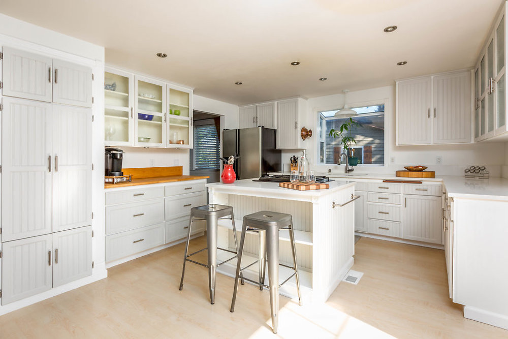 I love this kitchen...light, bright, & just right! Storage, recessed lighting, and a dash of country-contemporary flair make this kitchen so fun...