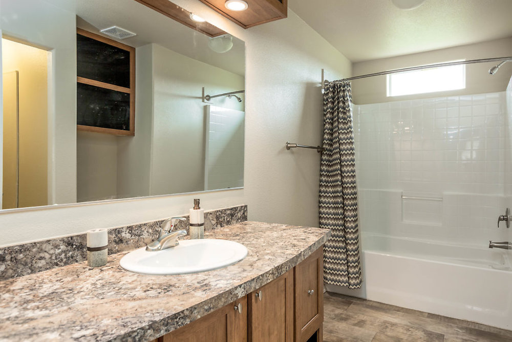 Spacious master bath with durable laminate flooring & walk in closet...