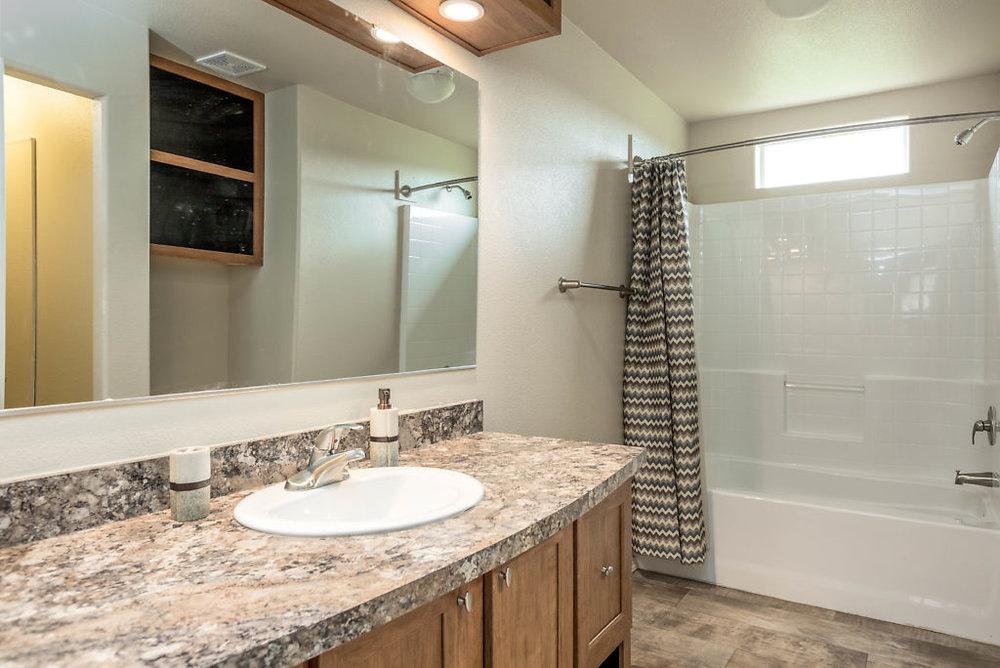 Spacious master bath with durable laminate flooring & walk in closet...