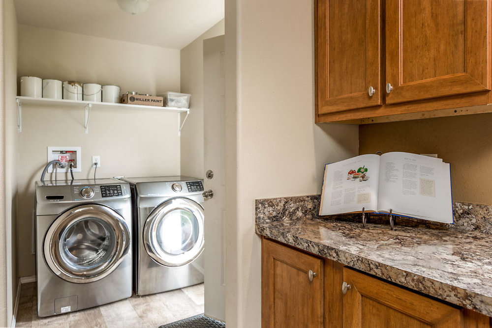 A convenient utility room with quality appliances...