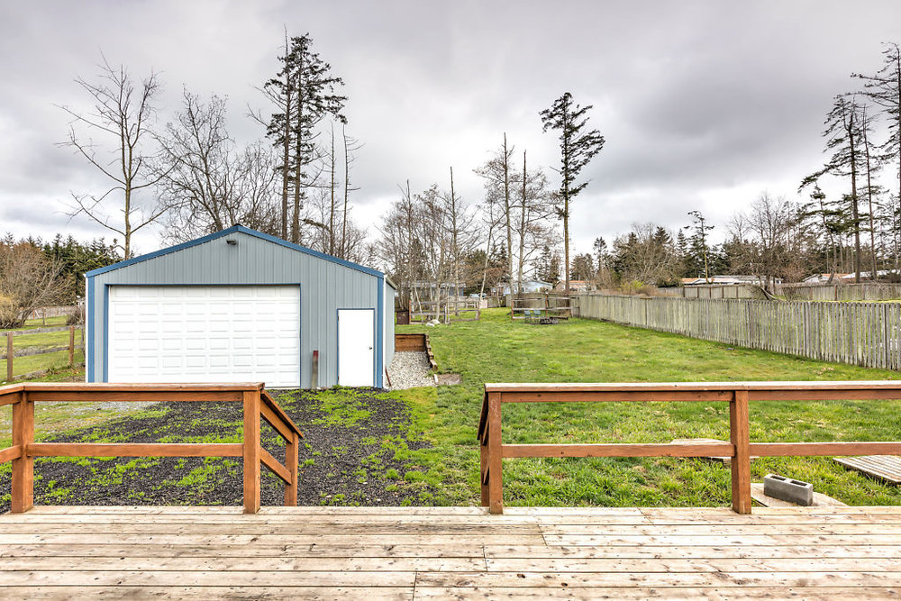 Now THAT's a view! Check out the detached garage/shop, huge fully fenced yard & an immense deck--perfect for entertaining & relaxing...