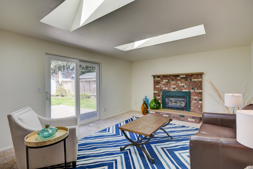Cozy natural gas fireplace....and access to the fenced back yard with oversized patio...perfect!