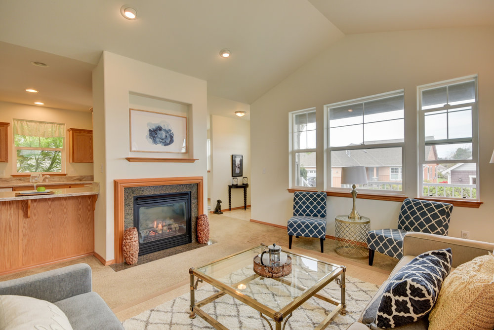 Gorgeous living room with vaulted ceilings, natural gas fireplace, & recessed lighting...