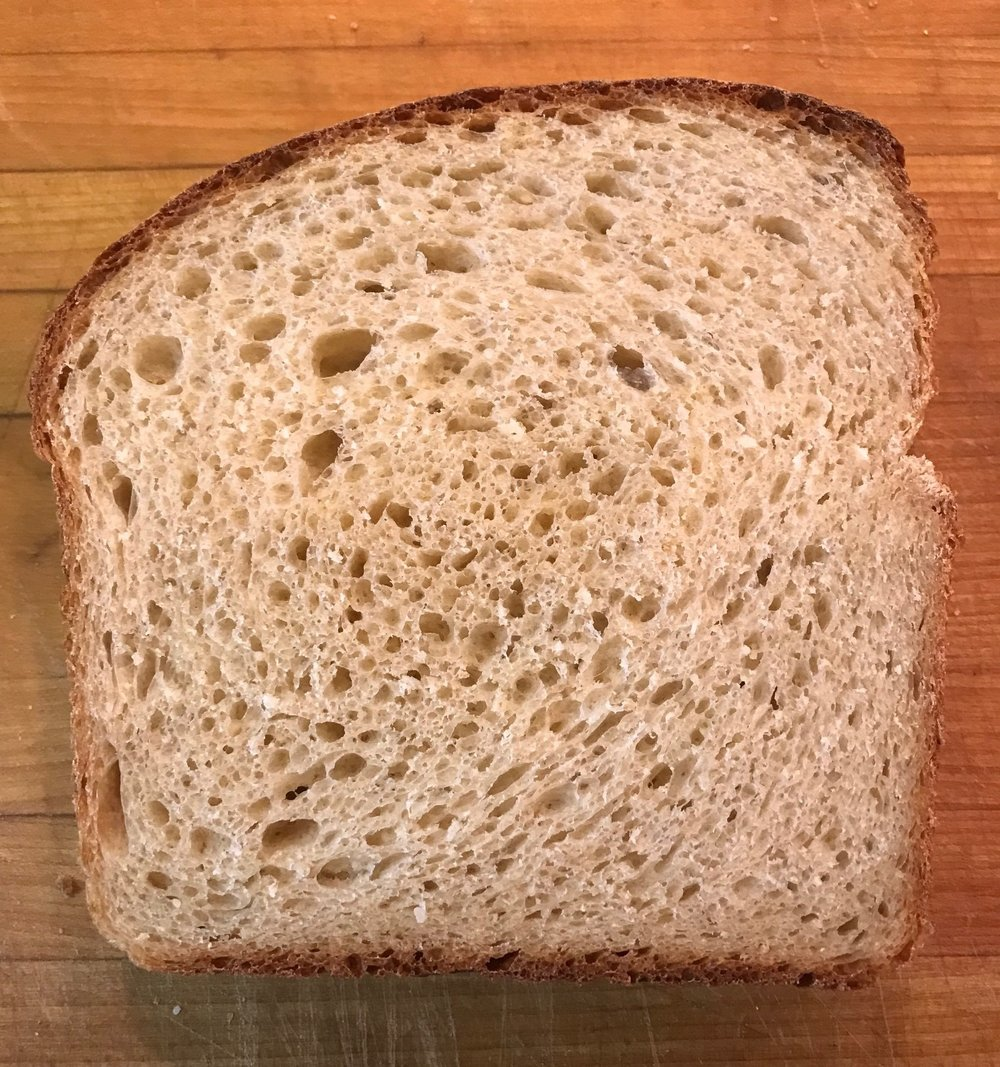 Beautiful crumb but loaf has an irregular shape due to my not letting it rest 20 minutes before shaping because i was so eager to bake the bread and see the results!