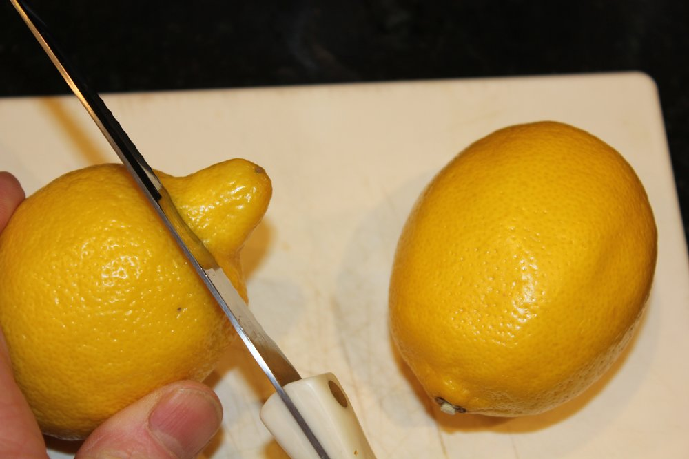 cutting off lemon end .jpg