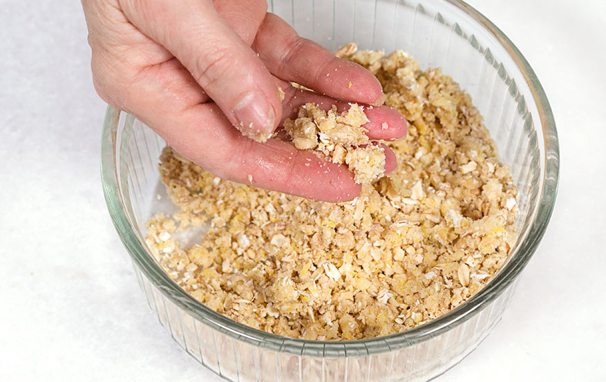 Mix the crumb topping until it begins to clump together.