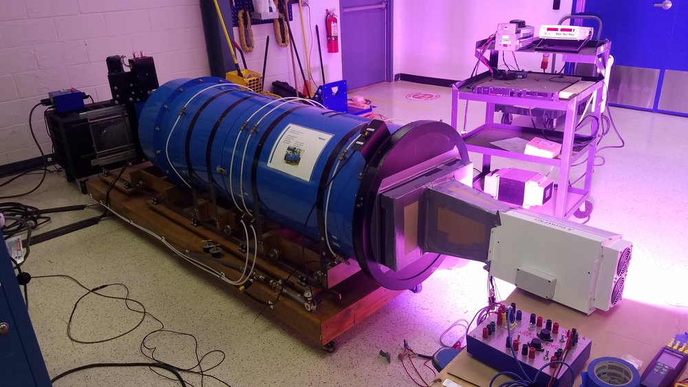 FluxScale 600AC instrumented and connected to a wind tunnel at ebm-papst. This tunnel precisely measures airflow; laser tachometers measure fan speed, and other instruments measure power and thermal performance.