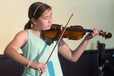 Violin student of Bravo, playing at our Annual Spring Recital