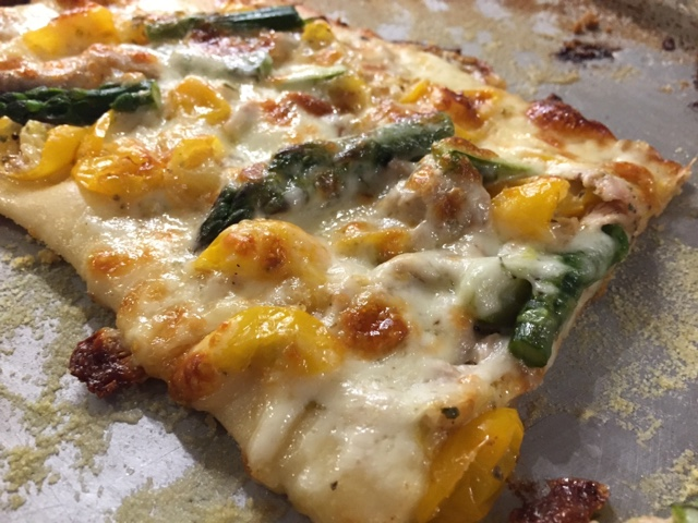 Cheesy asparagus tomato pizza