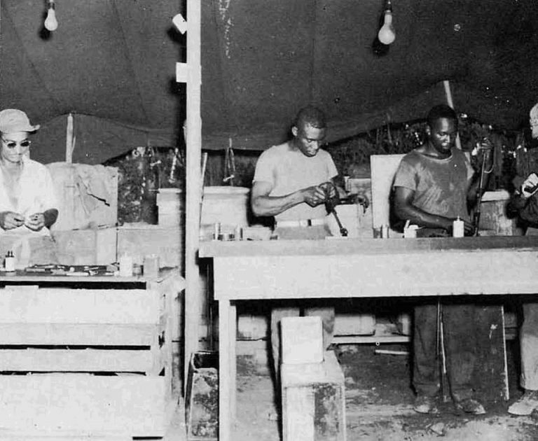 1942:    Armorers of the 34th Naval Construction Battalion worked to keep their weapons in first-class condition at all times on a Pacific island during World War II. The African American 34th Naval Construction Battalion was commissioned by Rear Admiral Lewis B. Combs at Camp Allen, Norfolk, VA. The 34th NCB was the first African American Seabee battalion in the Navy. (Photo courtesy of U.S. Navy Seabee Museum)