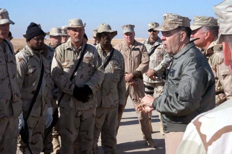 2004:    Al Asad, Iraq – Third Marine Air Wing Commanding General, Brig. Gen. Keith J. Stalder, thanks Seabees assigned to Naval Mobile Construction Battalion Two Three (NMCB-23) for the renovation of the new flight line at Al Asad Airport in Iraq. The activated reservist Seabees of NMCB-23 repaired nineteen impact craters to expand flight line operations and help rebuild Iraq. (U.S. Marine Corps photo by Lance Cpl. William L. Dubose III)