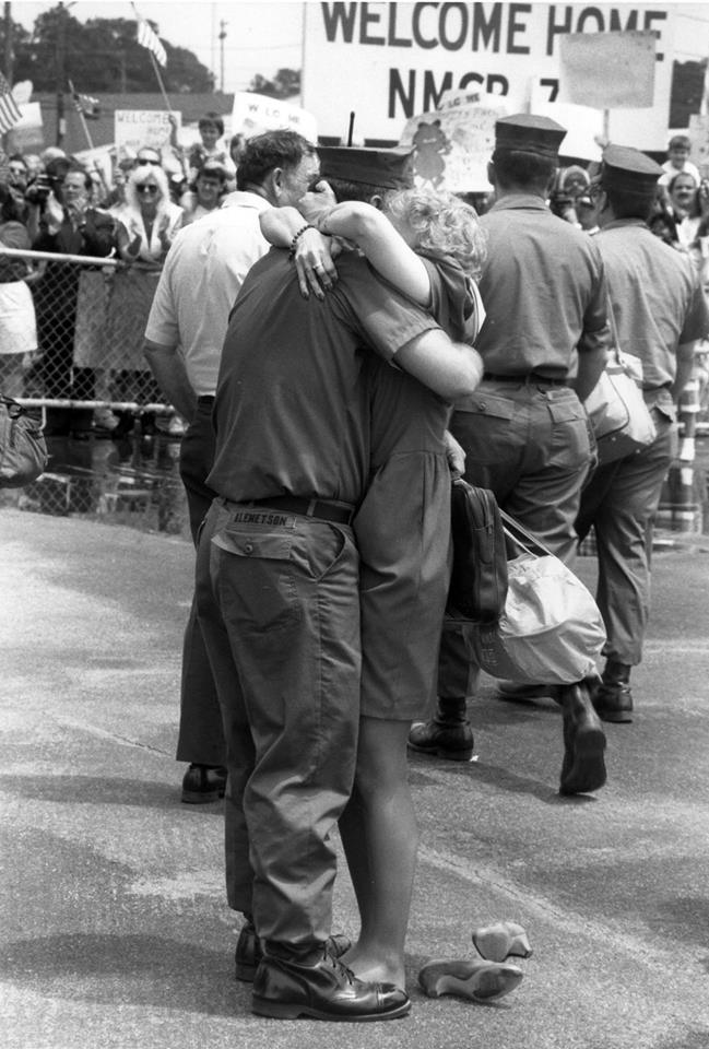 "1966:    Family and friends turn out to welcome home Naval Mobile Construction Battalion 74 from deployment. The battalion re-commissioned December 6, 1966, at the Naval Construction Battalion Center in Gulfport and adopted the motto ""Does More."" Since 1966, NMCB 74 has seen four deployments to Vietnam, deployed around the world to conduct humanitarian and civic action construction, earned nine ""Best of Type"" awards, four Peltier Awards, and the Presidential Unit Citation. (Courtesy U.S. Navy Seabee Museum)"