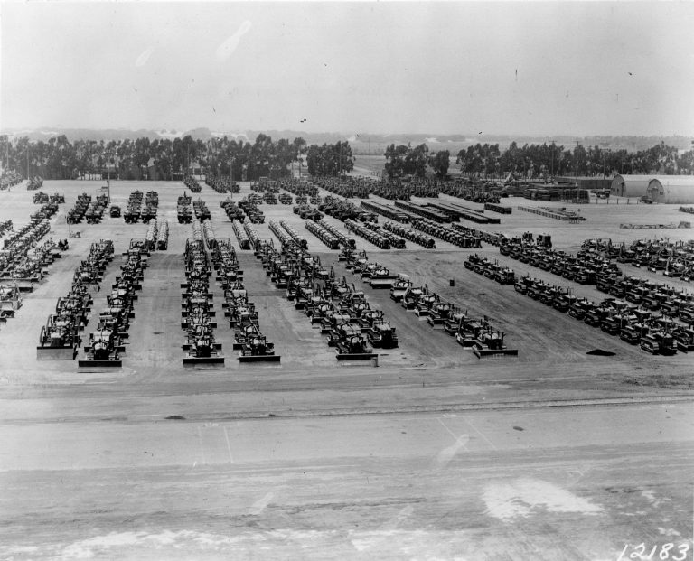 1954:    One of the largest auctions of used and unused naval equipment ever offered for sale was held 7-8 December 1954. Materiel valued at $8.1 million went up for auction including automotive, construction and industrial equipment as well as spare parts. Among the countless items being offered were 650 trucks, 54 cranes, rock crushers, scrapers, air compressors, pole trailer, cranes, graders, bucket loaders, winches, pumps, and generators, 20 February 1946. (Courtesy of U.S. Navy Seabee Museum)