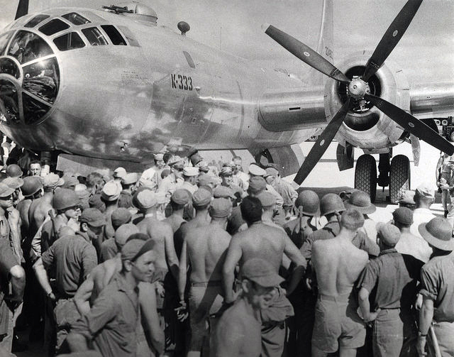The first B-29 Superfortress bombers land Dec. 21, 1944, at North Field on Tinian, the massive airbase being constructed by the 29th, 30th and 49th NCRs under the 6th NCB, commanded by Commodore Paul J. Halloran, CEC. Since July, the Seabees worked around the clock to construct North and West Fields on the island into the main B-29 bomber bases for the ensuing air campaigns against the Japanese home islands. (Photo courtesy of U.S. Navy Seabee Museum)