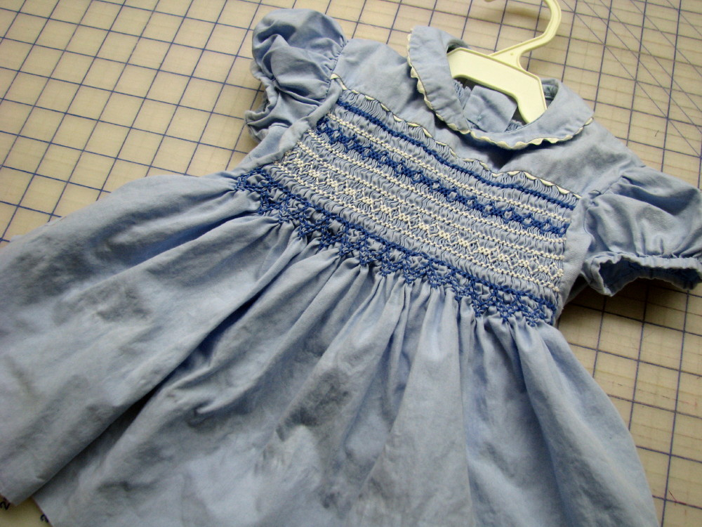 I made this little dress in the mid 1960's with the iron-on transfer of blue dots for the smocking.  This is one of 3 dresses I made with smocking.