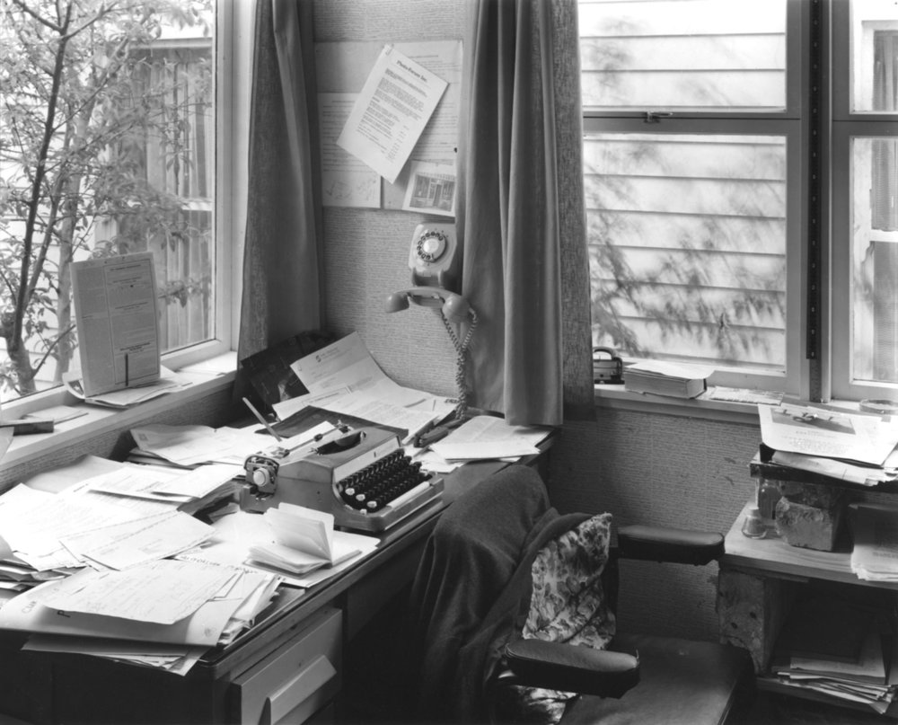 John Fields.  John B.Turner's desk at 43 Woodside Road, Mt Eden , 1975. Collection of John B. Turner. Published in  PhotoForum at 40: Counterculture, Clusters, and Debate in New Zealand  by Nina Seja, Rim Books, 2014.