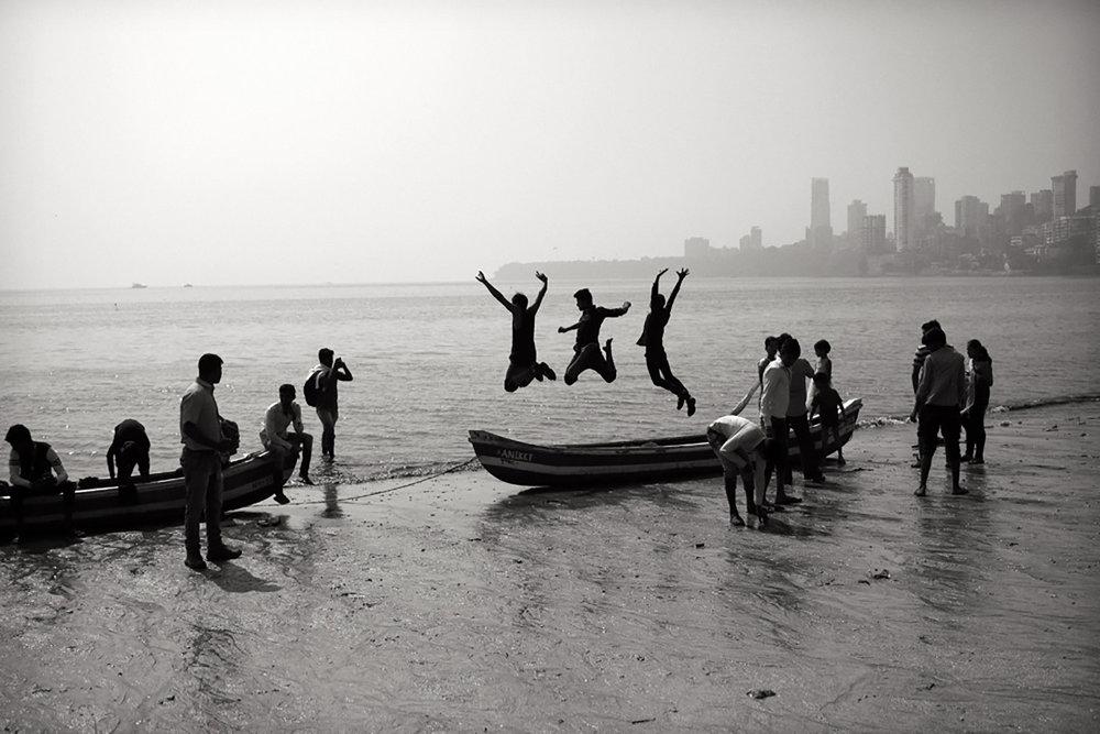 Julian Ward  Three Boys Jumping. Mumbai, India  2018
