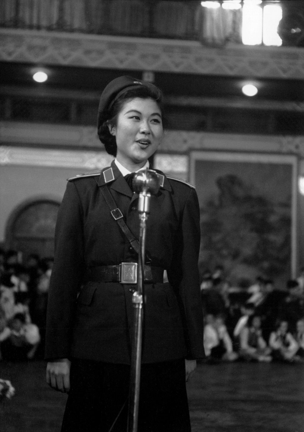 A People's Army announcer at the International Children's Day celebration held in the Peking Hotel.She had lipstick on, which was a very rare sight in China then.. Peking, China, 1 June 1956. (RDH C022-20)