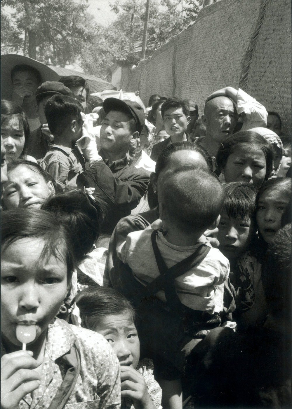 A crowd on a hot day at a peasant's fair in a country village near Peking. China, 1956.  (RDH C031-10a)