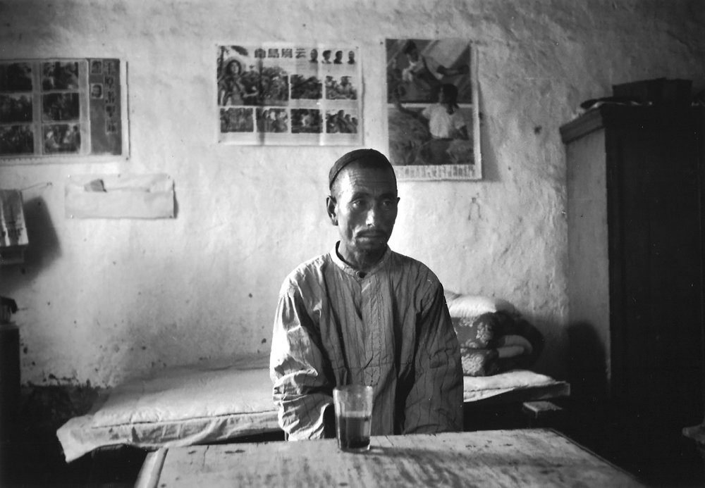 Uighur peasant at a cooperative farm on the outskirts of Urumchi. It was obvious that his status was inferior to that of the Chinese co-chairman of the farm. China, July 1956. (RDH C097-33)