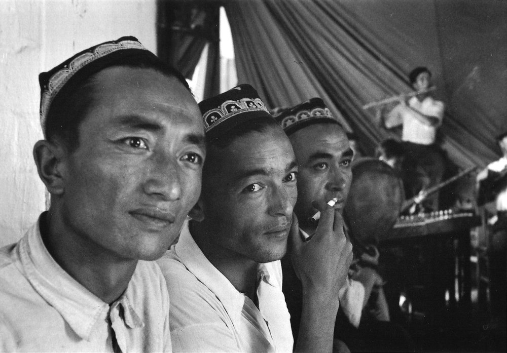 Uighur men at a theatre group's rehearsal of Uighur dances and music at Urumchi. China, July 1956. (C095-26a)
