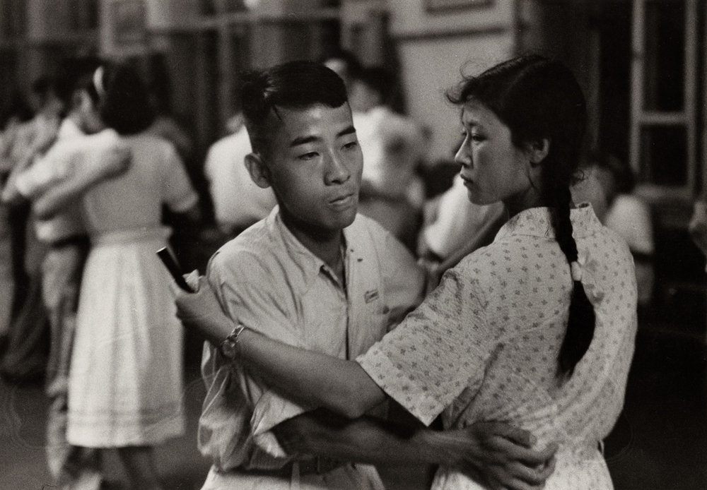 Saturday night dance in a workers' club at Changchun, north east China. There was a growing interest in European dance and music, but the relationship between the sexes was still rather formal. (RDH C131-8)