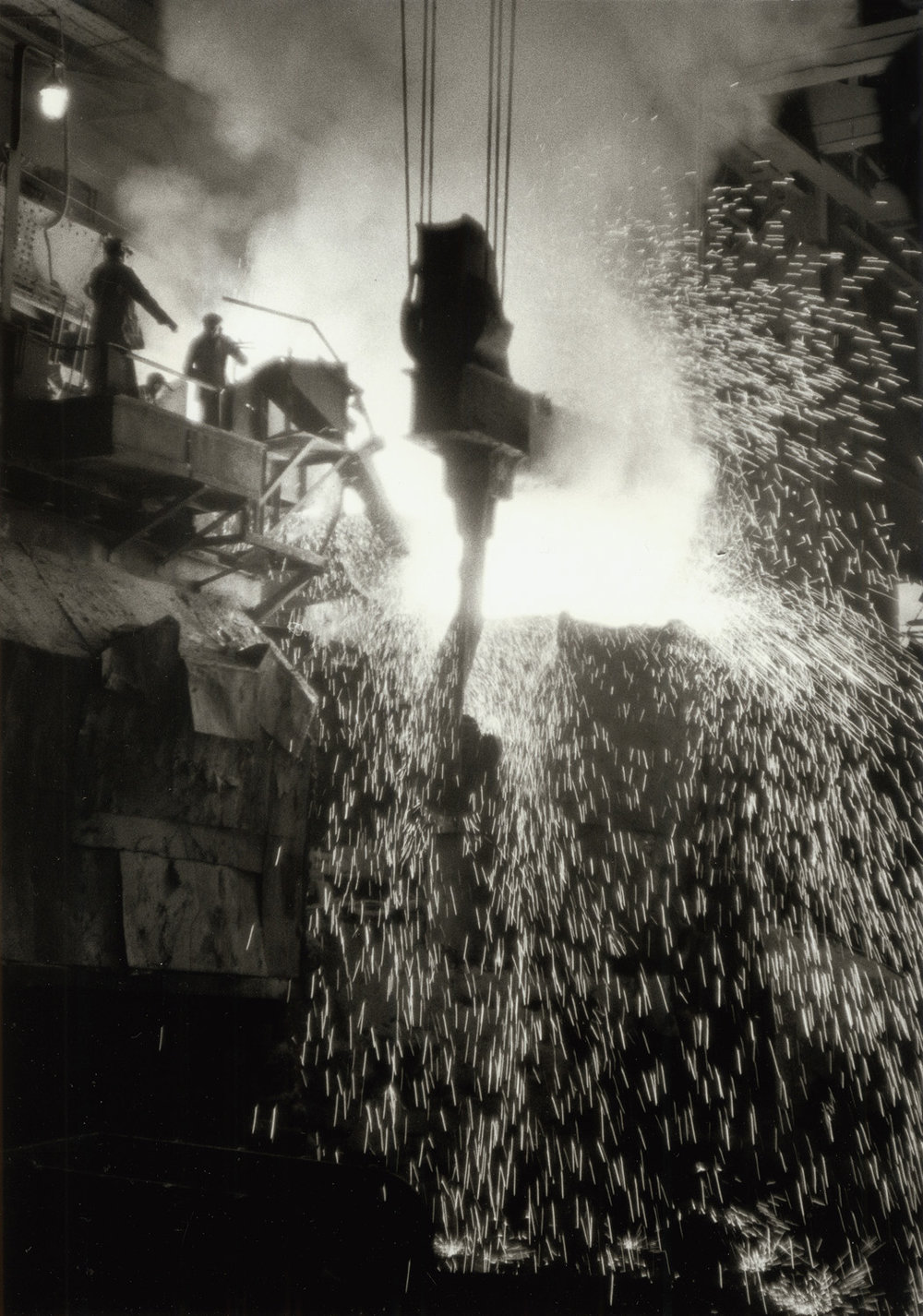 Pouring steel at an Anshan steel mill established by the Japanese during their occupation of China's north east during the 1930s and 1940s. China, August 1956. (RDH C124-5a)