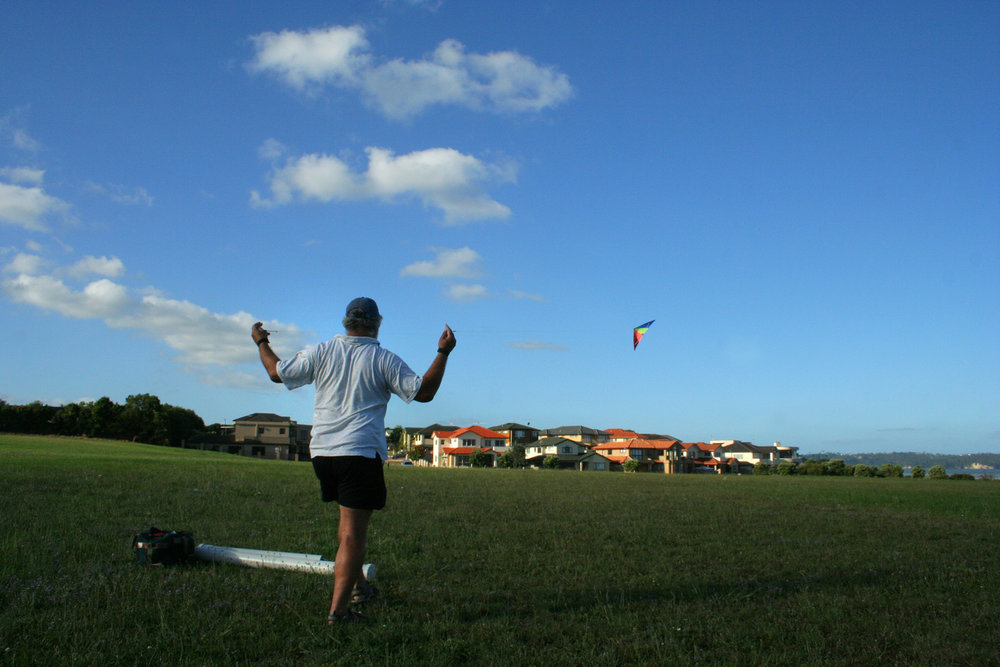 Peter Penny flying a kite, Harbour View, 5 February 2006. (JBT8656)
