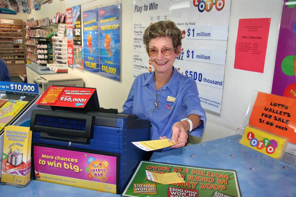 Gae, Lotto stand, Chemist's shop, Te Atatu Road, 12 March 2005. (JBT016)