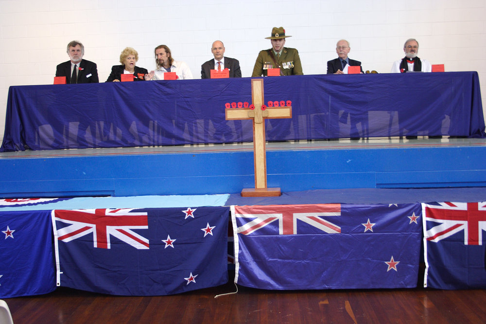 Local dignitaries, Te Atatu Peninsula Community Hall, Anzac Day, 25 April 2005. (JBT360) [Left to right: Matipo Primary school principal Wayne Bainbridge, Councilor Elizabeth Grimmer, Councilor Ewan Gilmour, Chris Carter, M.P., unidentified soldier and priest.
