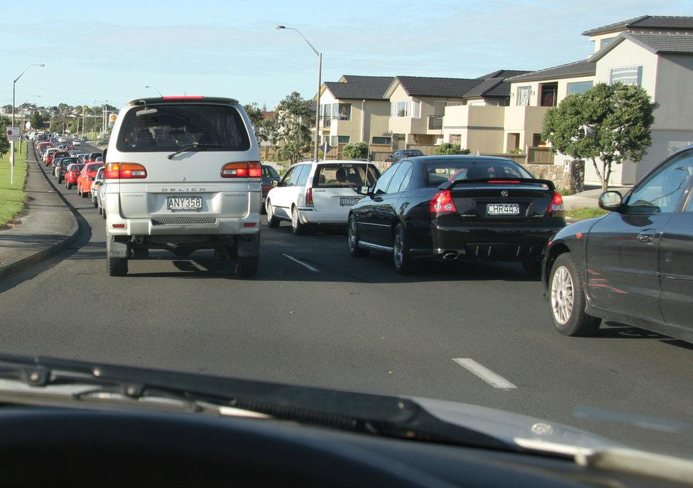 Traffic, 8.30am, Te Atatu Road, 1 March 2005. (JBT005NN)