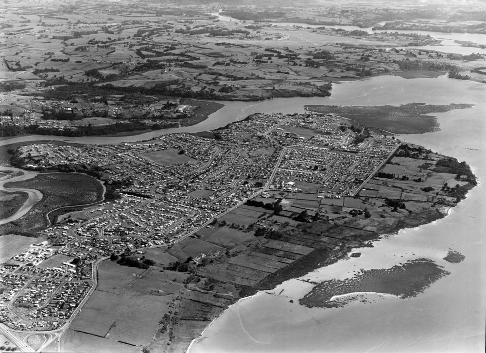 Aerial photograph of Te Atatu Peninsula showing the clear distinction between the West and the East, between the land zoned residential and that zoned industrial, 19 Aug 1969. Whites Aviation Ltd, Alexander Turnbull Library, Wellington. (WA-68641-G)