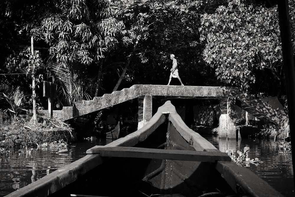 Julian Ward:  Man Crossing Bridge. Alapphuzha, Kerala, India.  2012