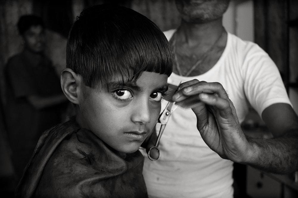 Julian Ward:  Boy at Barbers. Mewar, Rajasthan, India  2010