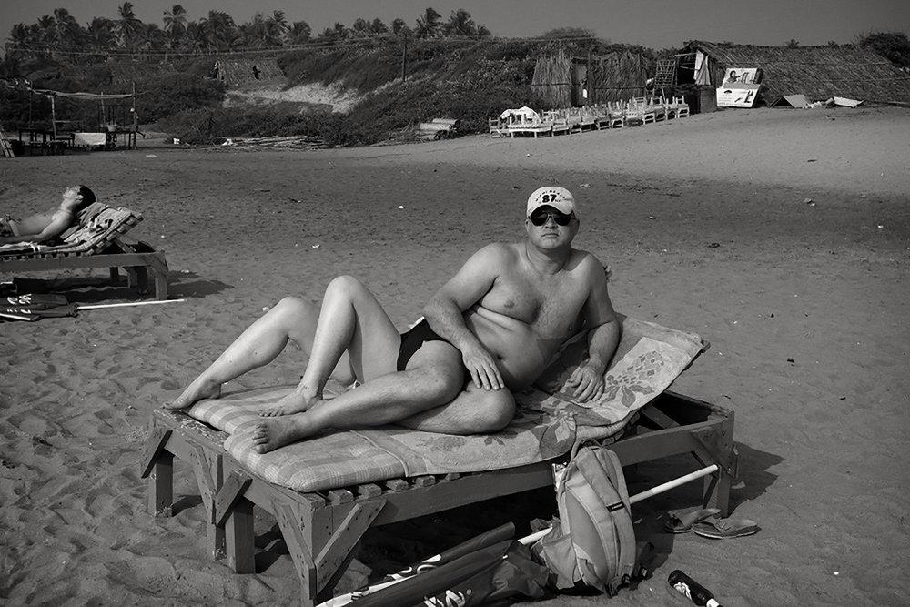 Julian Ward:  Man Sun Bathing. Calangute, Goa, India  2012