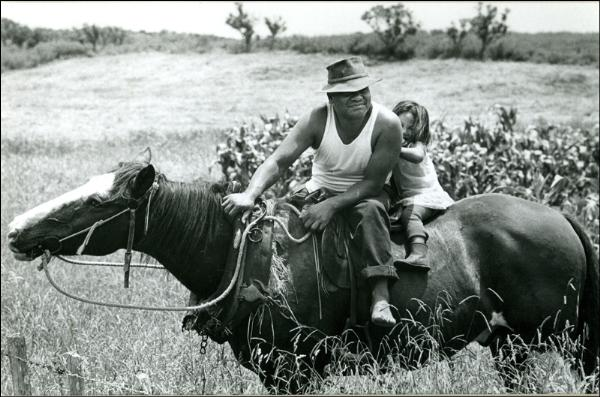 John Fields  Father and Daughter, East Cape , 1969. Published as a postcard by PhotoForum, 1976