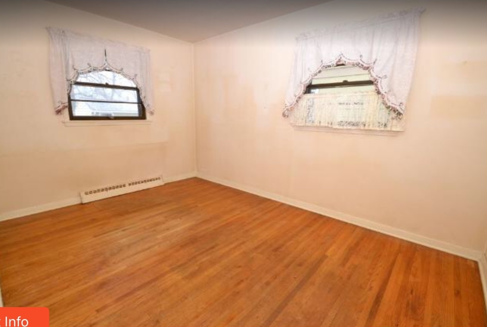 """The """"before""""- the window on the left is now the bathroom window, and the window on the right is gone. Needless to say, we didn't save the curtains..."""